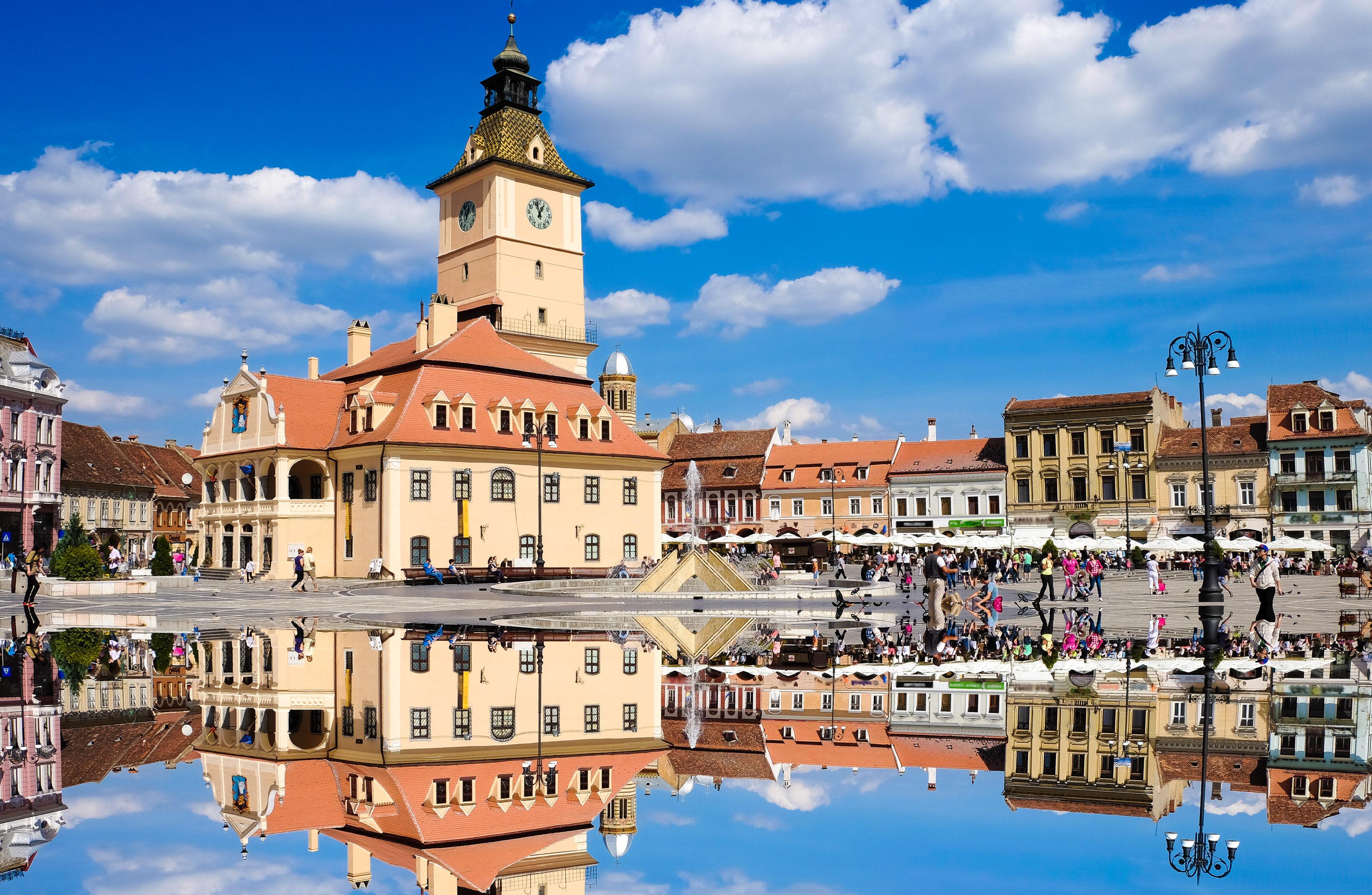 BRASOV, TRANSYLVANIA, ROMANIA. The old city center called Piata Sfatului. Important tourist attraction. One of the best cities in Transylvania. Artistic interpretation, mirror effect.